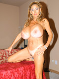 tanlined-woman-with-unbelievably-big-round-boobs-washes-her-hottest-body