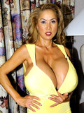 mature-sexbomb-minka-shows-her-humongous-boobs-without-removing-her-tight-yellow-dress