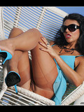 brunette-in-blue-dress-sunglasses-and-sheer-nylons-shows-her-boobs-and-muff