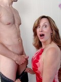 horny-mom-in-red-dress-gives-blowjob-then-her-enthusiastic-busty-daughter-helps-her