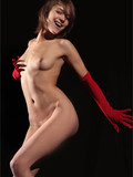 nude-art-photos-of-long-legged-naked-model-in-red-long-gloves-posing-in-the-dark