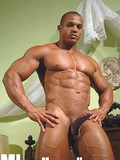 dark-skinned-bodybuilder-shows-off-his-iron-muscles-and-hard-meat-stick