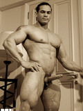 bodybuilder-shows-off-his-breathtaking-body-on-the-beach-and-exposes-his-dick-indoors