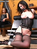 slave-girl-in-corset-and-stockings-gets-her-big-tits-and-bare-pussy-tortured