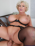 heavy-titted-blonde-milf-in-black-lingerie-gets-her-meaty-hairless-pussy-pounded