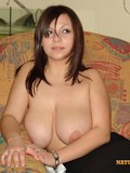 brown-haired-natural-chick-takes-off-her-big-size-white-bra-and-shows-her-heavy-breasts