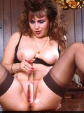 seductive-mommy-in-black-lingerie-and-nylons-rubs-glass-dildo-on-her-pussy