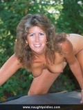 middle-aged-lady-with-natural-tits-and-trimmed-pussy-poses-nude-outdoors