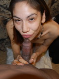 skinny-exotic-girlfriend-sucks-her-man-s-black-cock-on-camera-shamelessly