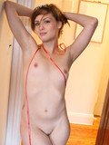 average-girl-with-tiny-tits-and-hairless-mound-poses-naked-at-home-and-blows-you-a-kiss