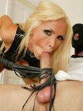 aggressive-pornstar-in-leather-outfit-posing-and-kinkily-playing-with-the-bound-guy