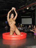 busty-black-haired-stripper-nina-mercedez-bares-it-all-and-gets-wet-in-the-kiddie-pool-in-a-club