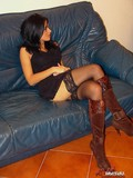 sexy-brunette-takes-off-her-high-brown-boots-and-poses-in-black-nylons-for-camera-girl