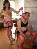 mature-man-dressed-in-female-underwear-gets-humiliated-by-woman-in-red-stockings