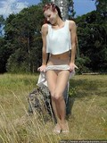 girl-in-transparent-pantyhose-lifts-her-skirt-up-but-palms-her-crotch-outdoors