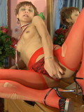 short-haired-tight-woman-in-red-stockings-and-black-shoes-plays-with-her-snatch