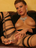 short-haired-elegant-lady-in-striped-nylons-sticks-glass-dildo-in-her-pussy
