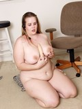 nude-plumper-plays-with-her-puffy-pussy-and-big-boobs-while-listening-to-music