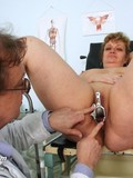 Plump mature woman strips nude to get her hairless pussy examined by doctor