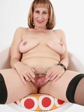 mature-lady-strips-down-to-her-black-stockings-then-spreads-her-pussy-and-buttocks