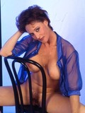 amazingly-sexy-milf-with-perfect-huge-tits-and-hairy-beaver-poses-in-transparent-blue-blouse