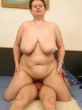 fat-mature-with-heavy-tits-sucks-boy-s-dick-then-rides-it-in-the-middle-of-a-big-bed
