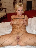 hot-euro-blonde-in-fishnet-body-stocking-and-boots-gets-fucked-by-three-men