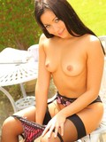 black-haired-elegant-cutie-with-small-tits-and-shaved-mound-strips-down-to-her-undies-outdoors
