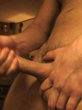 Completely naked amateur gay guy strokes his pistol in the semi-dark of the room