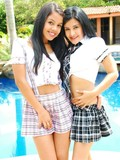 two-sexy-latinas-in-plaid-mini-skirts-posing-and-sharing-a-sturdy-meat-pole