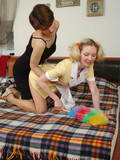 blonde-maid-in-yellow-uniform-and-pantyhose-gets-spanked-by-angry-brunette