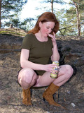 redhead-in-dress-and-boots-wears-no-panties-and-pisses-in-the-open-air