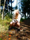 sexy-high-heeled-blonde-in-tight-light-blue-jean-shorts-caught-peeing-in-the-forest