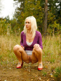 trimmed-pussy-blonde-in-pretty-short-sexy-skirt-peeing-in-the-open-air