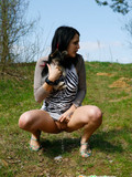 Leggy dark haired chick caught peeing in nature without taking off her sexy dress