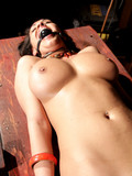 perfect-bodied-stacked-brunette-gets-tied-to-table-with-vibrator-between-her-legs