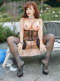 red-haired-latina-milf-in-stockings-and-corset-shows-off-her-wet-bubble-ass-and-has-sex-with-black