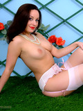 stockinged-pin-up-brunette-removes-her-white-dress-and-shows-her-pink-garter-belt
