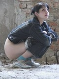brunette-girl-unzips-and-pulls-down-her-tight-jeans-to-pose-in-front-of-hidden-camera
