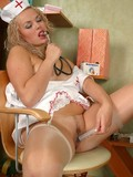 curly-haired-blonde-nurse-in-white-uniform-and-sheer-nylons-toys-her-pussy