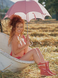 red-haired-cougar-scarlett-keegan-does-some-very-naughty-posing-outdoors