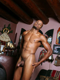 black-guy-with-strong-muscular-body-lazily-plays-with-his-dick-making-it-hard