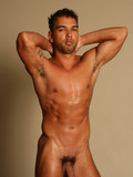 perfectly-sculptured-suntanned-man-shows-his-pretty-long-cock-and-muscled-torso