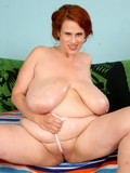 chunky-redhead-with-heaviest-boobs-strips-nude-and-gets-her-pussy-pounded