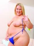 flirtatious-fair-haired-plumper-strips-out-of-her-bright-blue-lingerie