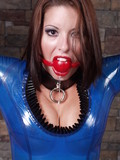 this-slave-lady-in-blue-latex-dress-and-with-red-gag-ball-in-her-sensual-mouth-is-helpless