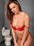 sexy-prisoner-in-red-lingerie-gets-her-throat-and-pussy-gagged-with-her-jailer-s-dick