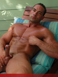 mouth-watering-bodybuilder-gets-his-strong-cock-out-to-masturbate-in-the-shadow