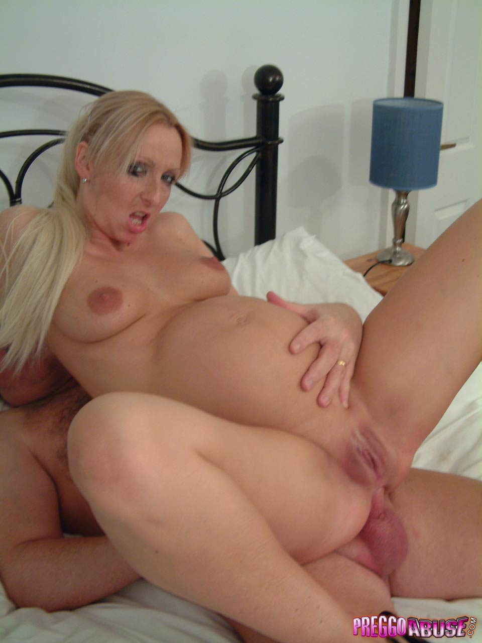 pregnant blonde with big belly gets her shaved pussy and anus