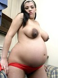 pregnant-girl-with-big-black-nipples-gets-nude-and-displays-her-hairless-puffy-pussy
